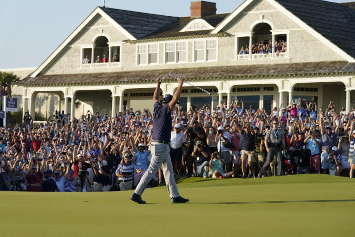 A maskless crowd cheers as Phil Mickelson celebrates after winning the final round at the PGA Championship golf tournament on the Ocean Course on Sunday, May 23, 2021, in Kiawah Island, S.C. (Matt York/AP)