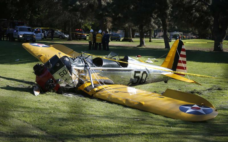 An airplane sits after crash landing at Penmar Golf Course in Venice California March 5, 2015. Celebrity web site TMZ reports the pilot was actor Harrison Ford, who was critically injured in the crash.  REUTERS/Lucy Nicholson   (UNITED STATES - Tags: DISASTER TRANSPORT ENTERTAINMENT)