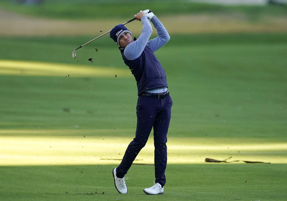 Justin Thomas hits his second shot on the 15th hole during the Genesis Invitational pro-am golf event at Riviera Country Club, Wednesday, Feb. 17, 2021, in the Pacific Palisades area of Los Angeles. (AP Photo/Ryan Kang)