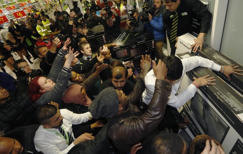 "Shoppers compete to purchase retail items on ""Black Friday"" at an Asda superstore in Wembley, north London"