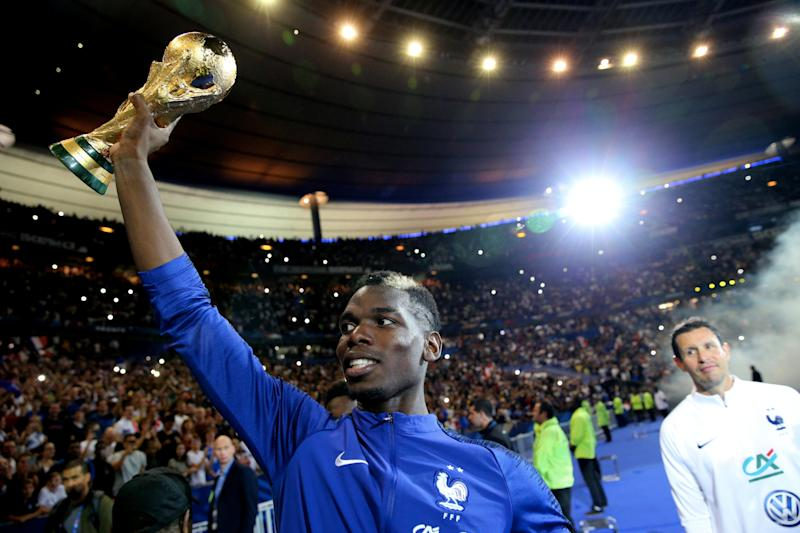 PARIS, FRANCE - SEPTEMBER 09: Paul Pogba of France celebrate the FIFA World Cup with fan after the UEFA Nations League A group one match between France and Netherlands at Stade de France on September 9, 2018 in Paris, France. (Photo by Xavier Laine/Getty Images)