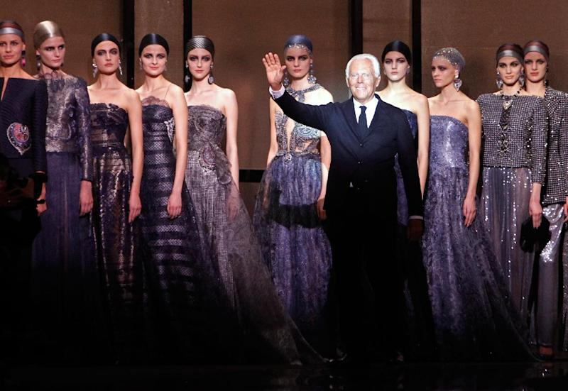 Fashion designer Giorgio Armani, foreground right, surrounded by models, acknowledges applause following the presentation of the Giorgio Armani Prive Spring-Summer 2014 Haute Couture fashion collection, presented Tuesday, Jan. 21, 2014 in Paris. (AP Photo/Thibault Camus)