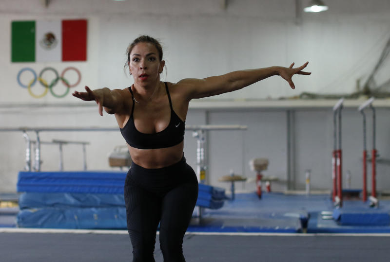 In this June 8, 2019 photo, Xyomara Valdivia, who will compete for Mexico in the women's fitness bodybuilding competition at the upcoming Pan Am Games, practices moves from her routine during a training visit to the Mexican Olympic Committee facilities in Mexico City. Valdivia and Carlos Suarez, who will compete in the men's classic bodybuilding category, will become the first Mexicans to represent their country in bodybuilding at the Pan Am Games, with this year marking the first time the discipline has been included as an official sport.(AP Photo/Rebecca Blackwell)