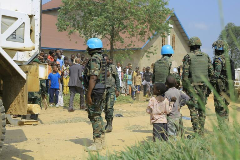 Malawian peacekeepers of the UN mission MONUSCO stand guard outside the church