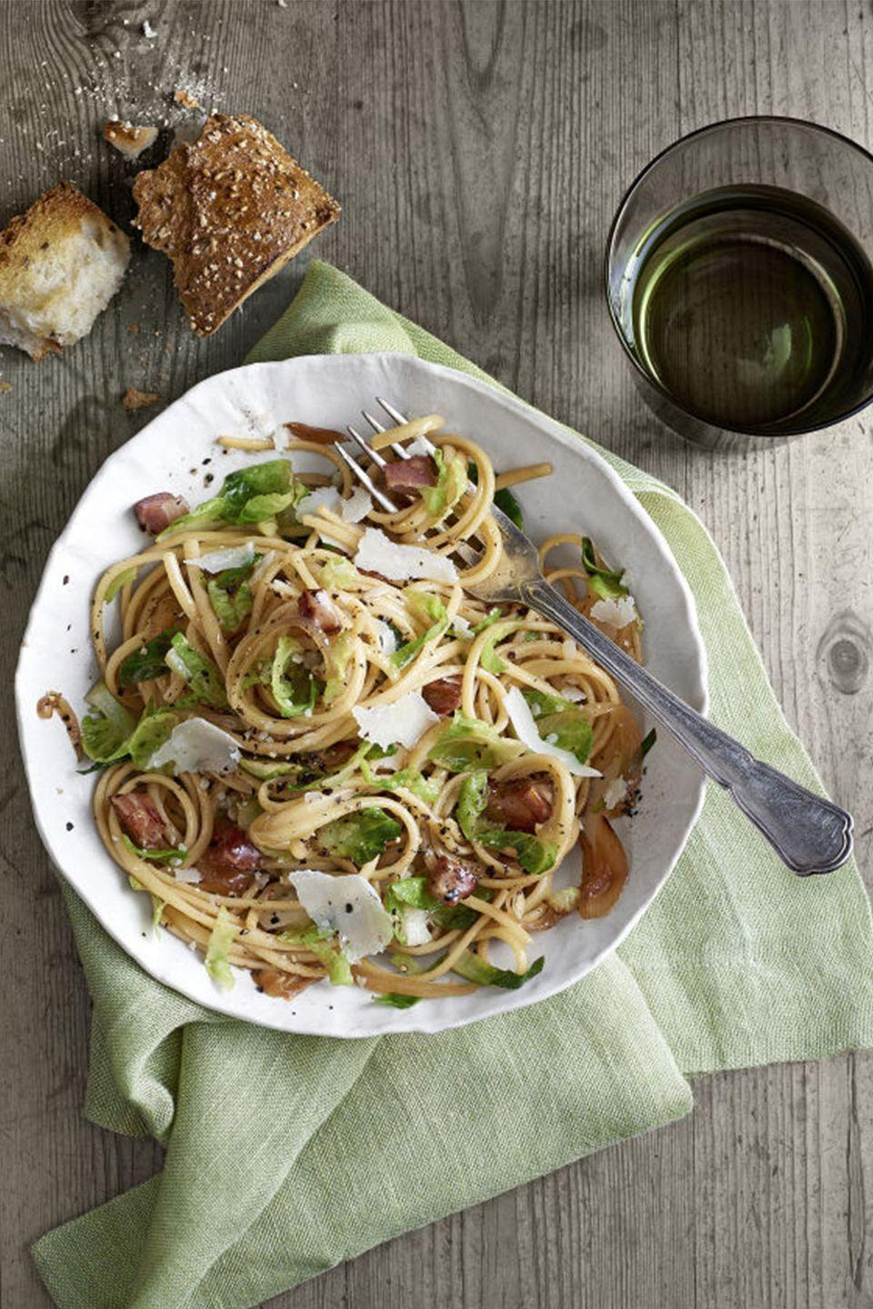 """<p>Make like Lady and the Tramp over a big bowl of linguini.</p><p><strong><a href=""""https://www.countryliving.com/food-drinks/recipes/a6337/pancetta-brussels-sprouts-linguini-recipe-clx0215/"""" rel=""""nofollow noopener"""" target=""""_blank"""" data-ylk=""""slk:Get the recipe"""" class=""""link rapid-noclick-resp"""">Get the recipe</a>.</strong> </p><p><a class=""""link rapid-noclick-resp"""" href=""""https://www.amazon.com/Victoria-Skillet-Seasoned-Flaxseed-Certified/dp/B01726HD72/?tag=syn-yahoo-20&ascsubtag=%5Bartid%7C10050.g.1115%5Bsrc%7Cyahoo-us"""" rel=""""nofollow noopener"""" target=""""_blank"""" data-ylk=""""slk:SHOP SKILLETS"""">SHOP SKILLETS</a></p>"""