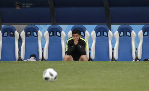 South Korea's Son Heung-min sits as he arrives for South Korea's official training on the eve of the group F match between Sweden and South Korea at the 2018 soccer World Cup in the Nizhny Novgorod stadium in Nizhny Novgorod, Russia, Sunday, June 17, 2018. (AP Photo/Lee Jin-man)
