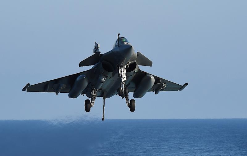 A French Rafale fighter jet involved in missions to Syria lands on the Charles-de-Gaulle aircraft carrier in the eastern Mediterranean Sea