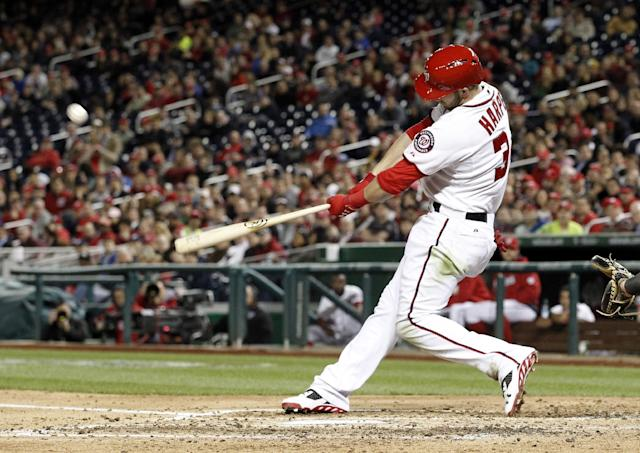 Washington Nationals' Bryce Harper hits a three-run homer during the fourth inning of a baseball game against the Miami Marlins at Nationals Park Wednesday, April 9, 2014, in Washington. (AP Photo/Alex Brandon)