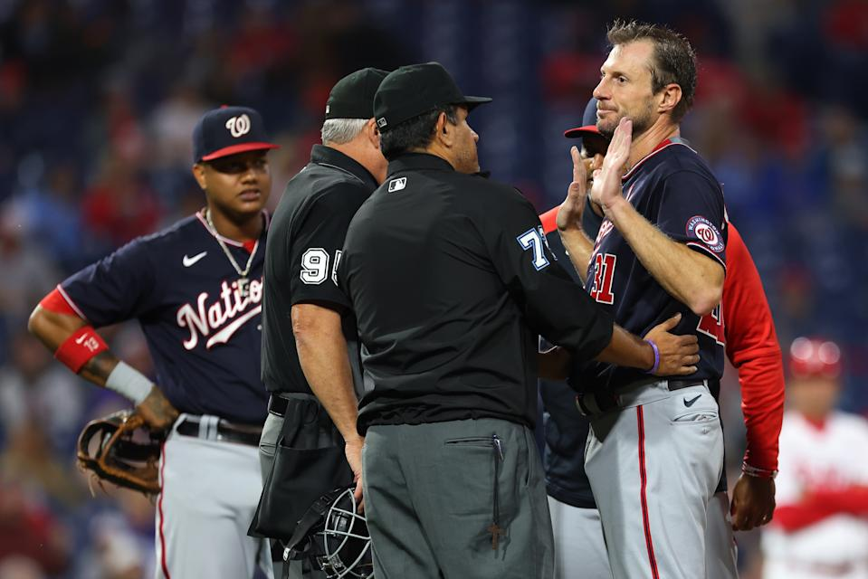PHILADELPHIA, PA - JUNE 22: Pitcher Max Scherzer #31 of the Washington Nationals is searched for foreign substances by umpires Tim Timmons #95 and Alfonso Marquez #72 during the fourth inning of a game against the Philadelphia Phillies at Citizens Bank Park on June 22, 2021 in Philadelphia, Pennsylvania. (Photo by Rich Schultz/Getty Images)