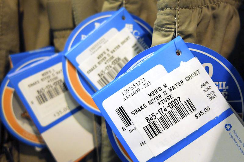 In this Friday, June 21, 2013, photo, price tags hang from clothes on display at an REI store in Pineville, N.C. The government reports on consumer prices for June on Tuesday, July 16, 2013. (AP Photo/Chuck Burton)