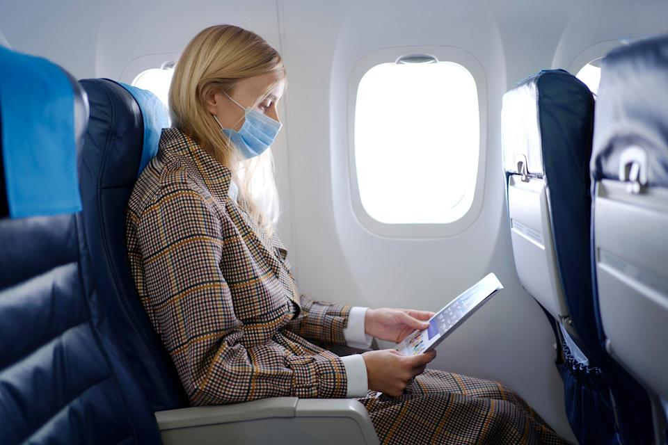 Even after getting the COVID-19 vaccine, you should wear a protective mask if you have to fly. (Photo: Getty Images)