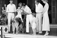 <p>While on vacation with Spain's King Juan Carlos and Queen Sofia, Prince Charles acquaints Prince Harry with the family dog.</p>