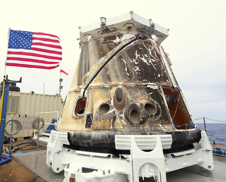 This photo provided by SpaceX shows the Dragon spacecraft on a boat in the Pacific Ocean on Thursday, May 31, 2012. Triumphant from start to finish, the Dragon parachuted into the Pacific on Thursday to conclude the first private delivery to the International Space Station and inaugurate NASA's new approach to exploration. (AP Photo/SpaceX)