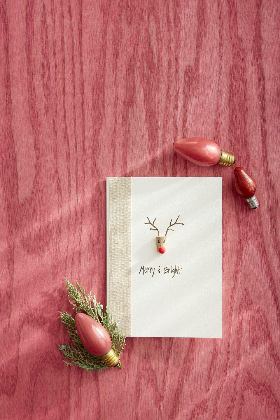 """<p>Send a bright red greeting from Rudolf, everyone's favorite spreader of holiday cheer.</p><p><strong>To make:</strong> Half a small craft cork. Use a black marker to draw on eyes and eye lashes. Attach a mini red pompom with glue. Glue cork to the front of a plain card. Use a fine tip brown felt marker to draw antlers and add a greeting. Add a ribbon flair to the fold edge of the card.</p><p><a class=""""link rapid-noclick-resp"""" href=""""https://www.amazon.com/Tapered-Wooden-Bottle-Stoppers-Replacement/dp/B089M4PBP7/ref=sr_1_16?tag=syn-yahoo-20&ascsubtag=%5Bartid%7C10050.g.3872%5Bsrc%7Cyahoo-us"""" rel=""""nofollow noopener"""" target=""""_blank"""" data-ylk=""""slk:SHOP CORKS"""">SHOP CORKS</a></p>"""