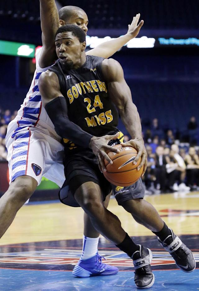 Southern Mississippi guard Michael Craig (24) drives to the basket against DePaul center Tommy Hamilton IV, during the first half of an NCAA college basketball game in Rosemont, Ill., Wednesday, Nov. 13, 2013. (AP Photo/Nam Y. Huh)