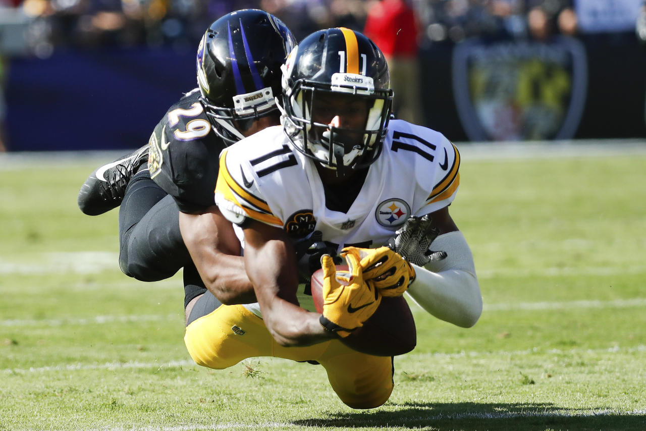 <p>Pittsburgh Steelers wide receiver Justin Hunter (11) is stopped by Baltimore Ravens defensive back Marlon Humphrey (29) during the second half of an NFL football game in Baltimore, Sunday, Oct. 1, 2017. (AP Photo/Alex Brandon) </p>