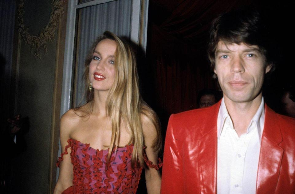 <p>Jerry Hall and Mick Jagger attending a party in Paris in 1982.</p>