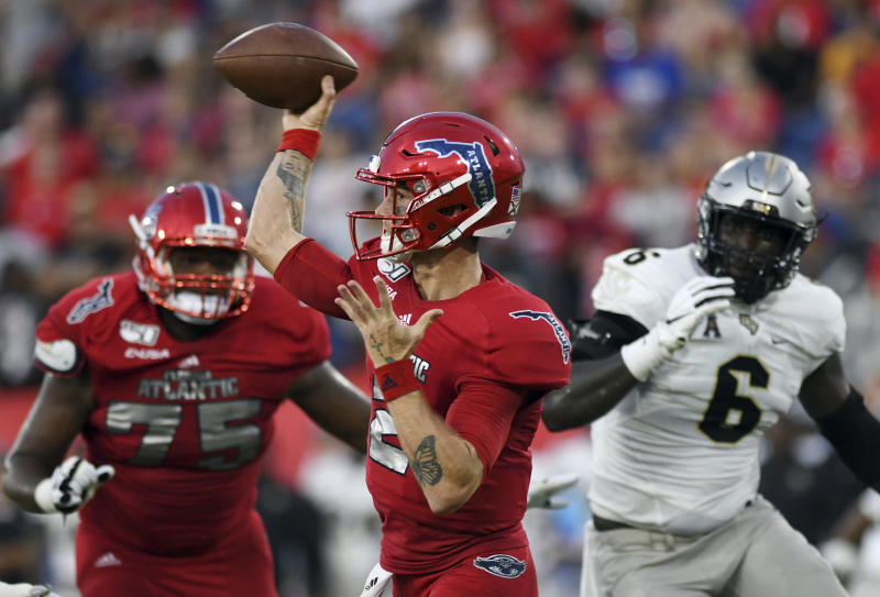 Florida Atlantic quarterback Chris Robison (2) throws a pass against UCF during the first half of an NCAA college football game Saturday, Sept. 7, 2019, in Boca Raton, Fla. (AP Photo/Jim Rassol)