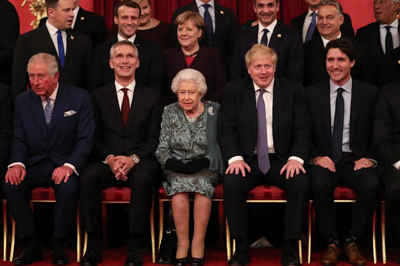 front row (L-R) Britain's Prince Charles, Prince of Wales, NATO Secretary General Jens Stoltenberg, Britain's Queen Elizabeth II, Britain's Prime Minister Boris Johnson and Canada's Prime Minister Justin Trudeau sit together at Buckingham Palace in central London on December 3, 2019, as leaders of Nato alliance countries, and its secretary general, join Queen Elizabeth II and the Prince of Wales for a group picture to mark 70 years of the alliance ahead of the NATO alliance summit. - NATO leaders gather Tuesday for a summit to mark the alliance's 70th anniversary but with leaders feuding and name-calling over money and strategy, the mood is far from festive. (Photo by Yui Mok / POOL / AFP) (Photo by YUI MOK/POOL/AFP via Getty Images)