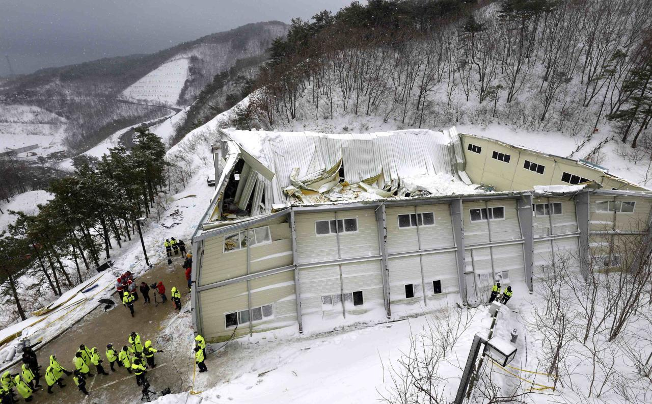 A collapsed resort building is seen in Gyeongju, about 375 km (235 miles) southeast of Seoul February 18, 2014. Ten people attending a welcoming party for new university students were killed when a building at a South Korean mountain resort collapsed late on Monday, emergency officials said, trapping dozens in snow and rubble for several hours. About 560 students had gathered in the auditorium of the golf resort in the mountains in the city of Gyeongju, around 375 km (235 miles) southeast of Seoul. Heavy snow had built up on the roof of the prefabricated building, causing it to collapse, fire department officials said. REUTERS/Lee Jae-hyuk/Yonhap (SOUTH KOREA - Tags: DISASTER SOCIETY TPX IMAGES OF THE DAY) ATTENTION EDITORS - NO SALES. NO ARCHIVES. FOR EDITORIAL USE ONLY. NOT FOR SALE FOR MARKETING OR ADVERTISING CAMPAIGNS. THIS IMAGE HAS BEEN SUPPLIED BY A THIRD PARTY. IT IS DISTRIBUTED, EXACTLY AS RECEIVED BY REUTERS, AS A SERVICE TO CLIENTS. SOUTH KOREA OUT. NO COMMERCIAL OR EDITORIAL SALES IN SOUTH KOREA