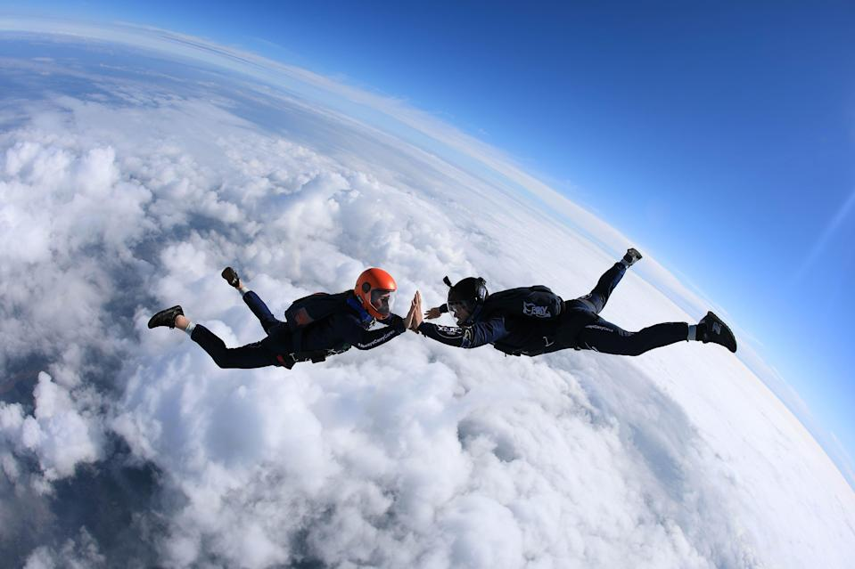 Emily Aucutt and Josh Carratt during their skydiving high five record attempt (Gary Wainwright/Carex/PA)