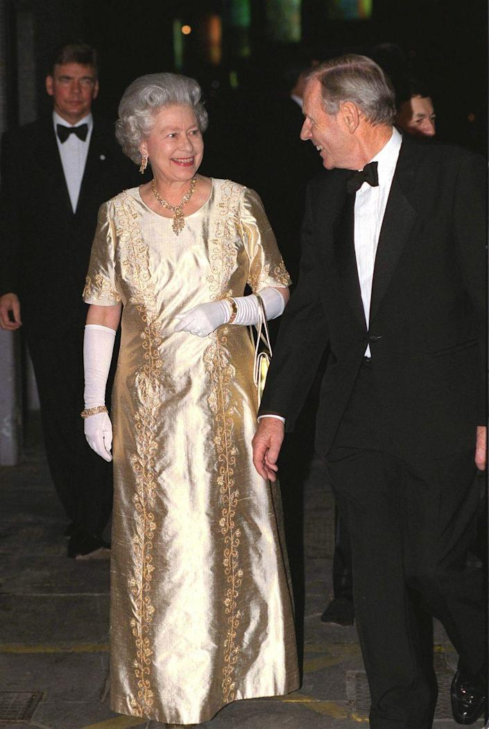 <p>Always one for situational dressing, Queen Elizabeth wore a metallic shantung silk evening gown to celebrate her golden wedding anniversary in 1997. </p>