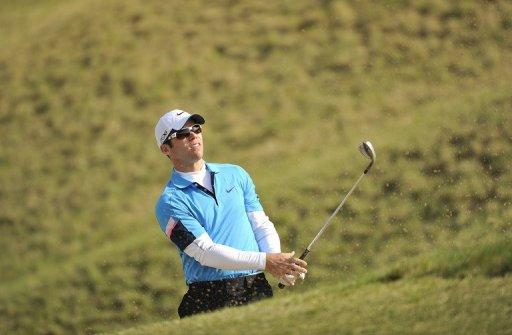 "English golfer Paul Casey hits a bunker shot during day two of the Ballantine's Championship at the Blackstone Resort in South Korea on April 27. Casey told AFP he is still hunting for the missing ""edge"" that put him among golf's elite after three years of injury problems, including a snowboarding accident, knocked his career sideways"