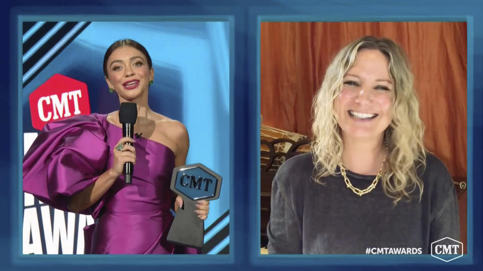 "In this video image provided by CMT, Sarah Hyland, left, presents Jennifer Nettles the ""CMT Equal Play Award"" during the Country Music Television awards airing on Wednesday, Oct. 21, 2020. (CMT via AP)"