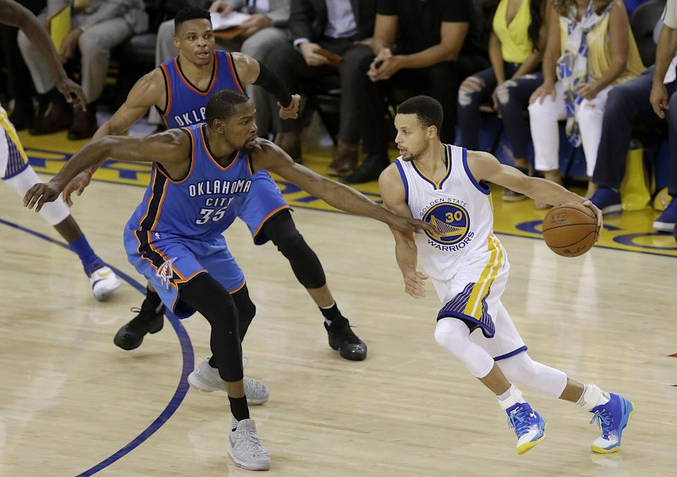 The next time these three players share the court, Stephen Curry and Kevin Durant will be the ones wearing the same jersey. (AP/Ben Margot)