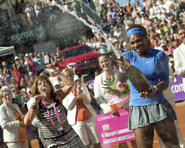 Serena Williams celebrates after winning her 53rd WTA title by beating Johanna Larsson, not shown, by 6-4, 6-1 in the final of the Swedish Open on Sunday, July 21, 2013 in Bastad, Sweden. (AP Photo/Bjorn Larsson Rosvall, Scanpix) SWEDEN OUT