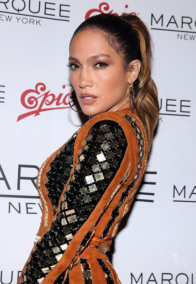 <p>Sporting her signature glow and a high ponytail, Lopez looked sizzling hot at the Epic Summer party hosted by DJ Khaled in New York City. (Photo: Getty Images) </p>