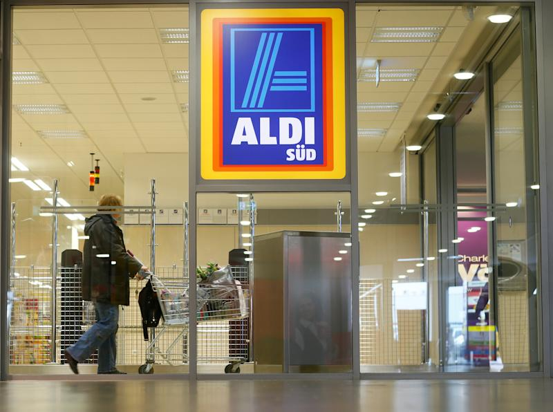 RUESSELSHEIM, GERMANY - APRIL 8: A shopper pushes a shopping cart in an Aldi store on April 8, 2013 in Ruesselsheim near Frankfurt, Germany. Aldi, which today is among the world's most successful discount grocery store chains, will soon mark its 100th anniversary and traces its history back to Karl Albrecht, who began selling baked goods in Essen on April 10, 1913 and founded the Aldi name by shortening the phrase Albrecht Discount. His sons Karl Jr. and Theo expanded the chain dramatically, creating 300 stores by 1960 divided between northern and southern Germany, with Aldi Nord and Aldi Sued, respectively. Today the two chains have approximately 4,300 stores nationwide and have also expanded into other countries across Europe and the USA. Aldi Nord operates in the USA under the name Trader Joe's. (Photo by Ralph Orlowski/Getty Images)
