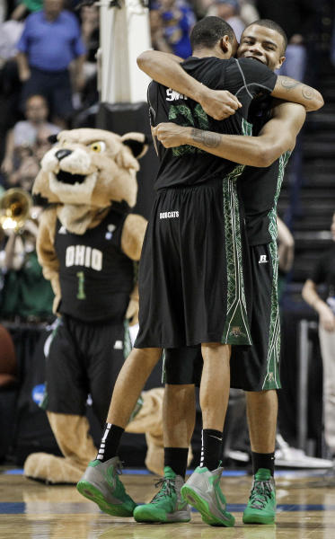Ohio's Reggie Keely, right, and Jon Smith (21) celebrate after Ohio defeated South Florida 62-56 in a third-round NCAA college basketball tournament game Sunday, March 18, 2012, in Nashville, Tenn. (AP Photo/Mark Humphrey)