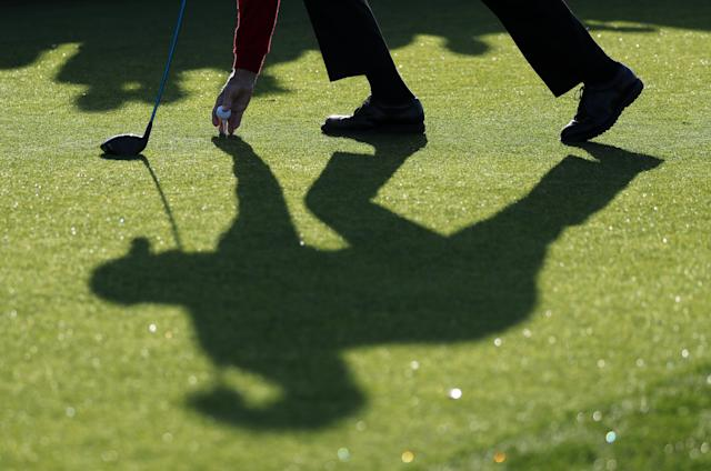 Honorary starter Jack Nicklaus of the U.S. casts a shadow as he tees up during the ceremonial start before first round play in the 2018 Masters golf tournament at the Augusta National Golf Club in Augusta, Georgia, U.S. April 5, 2018. REUTERS/Lucy Nicholson
