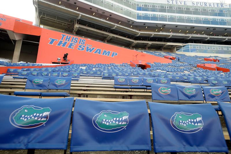 Florida Gator seat backs sit in the stands of Ben Hill Griffin Stadium before an NCAA college football game against North Texas in Gainesville, Fla., Saturday, Sept. 17, 2016. (AP Photo/Phelan M. Ebenhack)