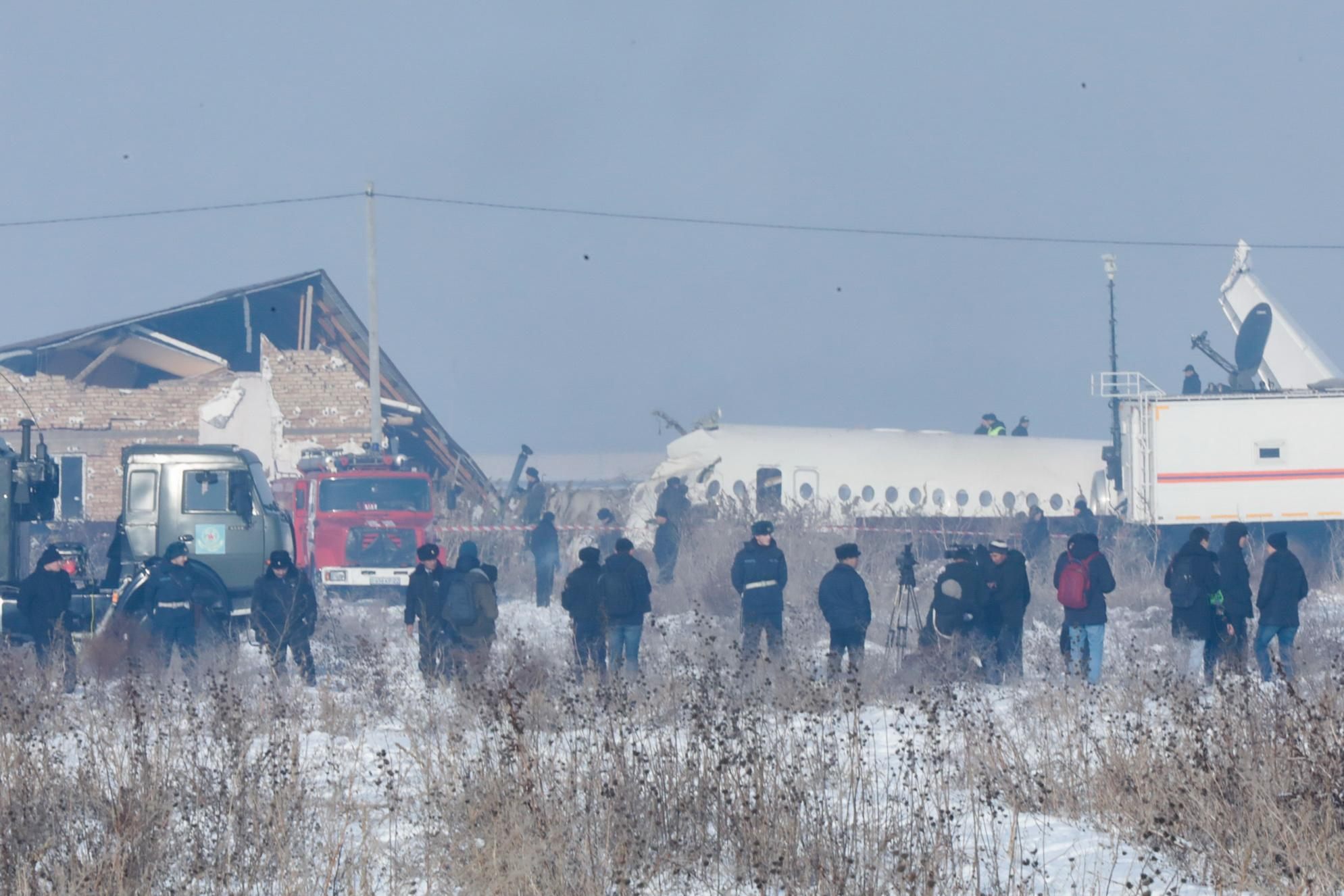 ALMATY, KAZAKHSTAN - DECEMBER 27, 2019: The site of a crash of a Bek Air plane carrying 95 passengers and 5 crew members near Almaty Airport. A Bek Air Fokker 100 passenger plane flying from Almaty to Nur-Sultan has crashed minutes after takeoff, broken through a concrete guardrail and clashed into a two-storey building. The accident has killed at least 14 people, dozens have been injured. Pavel Aleksandrov/TASS (Photo by Pavel Aleksandrov\TASS via Getty Images)