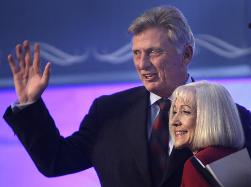 Arkansas Gov. Mike Beebe waves as his wife Ginger looks on during inauguration ceremonies at the Arkansas state Capitol in Little Rock, Ark., Tuesday, Jan. 11, 2011. (AP Photo/Danny Johnston)