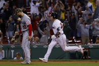 Boston Red Sox's Bobby Dalbec runs the bases past Los Angeles Angels first baseman Jared Walsh after his two-run home run during the seventh inning of a baseball game Friday, May 14, 2021, at Fenway Park in Boston. (AP Photo/Winslow Townson)