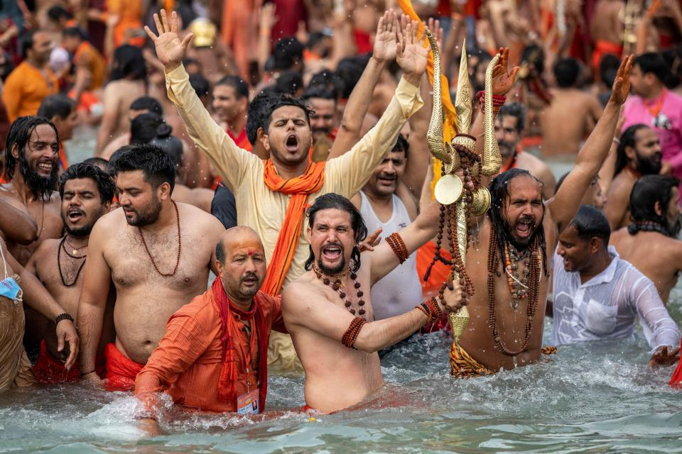 Sadhus, or Hindu holy men take a dip in the Ganges river during Shahi Snan at