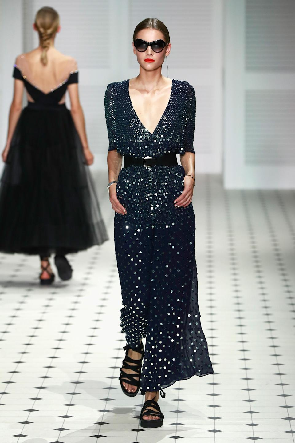 <p>A breathtaking deep-V dress that reminds us of the night sky — or a glittering sea. </p>