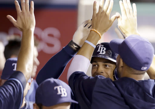 Tampa Bay Rays' Desmond Jennings celebrates with teammates after his solo home run against the Los Angeles Angels in the third inning of a baseball game in Anaheim, Calif., Tuesday, Sept. 3, 2013. (AP Photo/Reed Saxon)