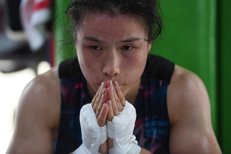 This photo taken on August 7, 2019 shows Chinese mixed martial arts (MMA) fighter Zhang Weili resting during a break in training at a gym in Beijing. - Zhang can become China's first UFC world champion if she beats title-holder Jessica Andrade of Brazil in their strawweight showdown at the end of August. (Photo by GREG BAKER / AFP) / TO GO WITH MMA-UFC-CHN-China-Zhang-women,INTERVIEW by Helen ROXBURGH (Photo credit should read GREG BAKER/AFP/Getty Images)