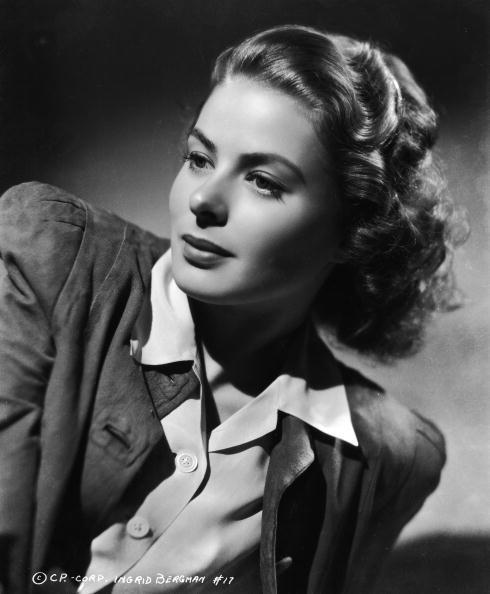 <p>Ingrid Bergman poses for a publicity shot wearing a blouse and jacket. </p>