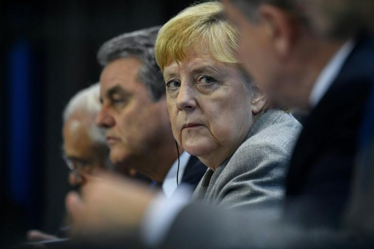 """Chancellor Merkel's finance ministry has said """"Germany has the firepower for a real crisis"""" with stimulus and structural reform plans at the ready if needed (AFP Photo/John MACDOUGALL)"""