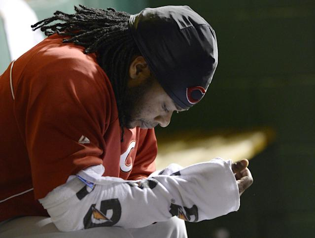 Cincinnati Reds starting pitcher Johnny Cueto sits on the bench in the fourth inning of the NL wild-card playoff baseball game against the Pittsburgh Pirates on Tuesday, Oct. 1, 2013, in Pittsburgh. (AP Photo/Don Wright)