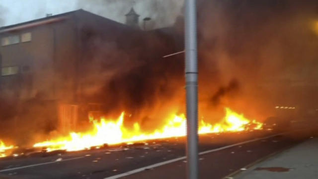 In this image taken from amateur video, showing a line of flaming debris shortly after a helicopter crash in central London, early Wednesday Jan. 16, 2013. Police say two people were killed when a helicopter crashed during rush hour in central London after apparently hitting a construction crane on the side of St. George's Tower in the Vauxhall area of central London. (AP Photo / Nic Walker) TV OUT