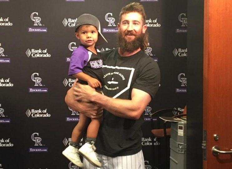 Rockies All-Star Charlie Blackmon hangs out with his two-year-old superfan Tommy Carlson. (Rockies)