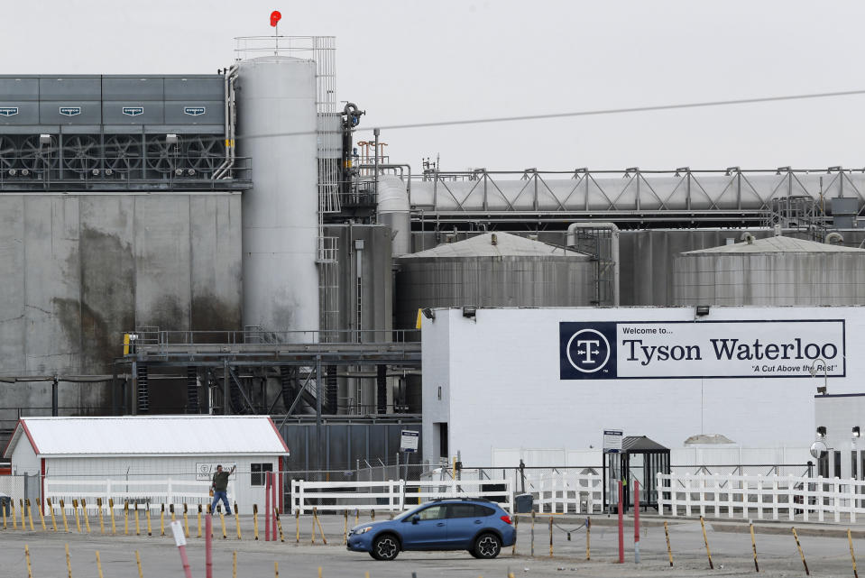 FILE - In this Friday, May 1, 2020, photo, a worker leaves the Tyson Foods plant in Waterloo, Iowa. Hundreds of meatpacking workers have been vaccinated against the coronavirus but the union that represents them says several hundred thousand more have not, despite the risks they continue to face at work. (AP Photo/Charlie Neibergall, File)