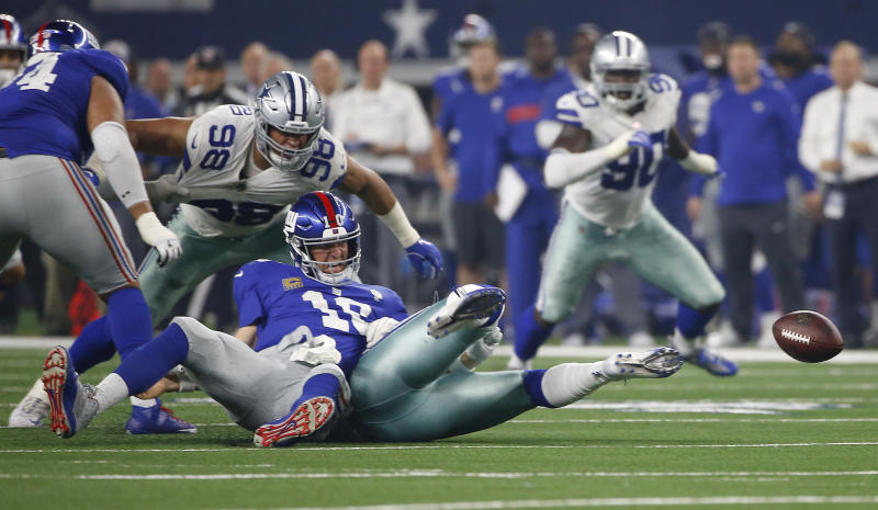 New York Giants quarterback Eli Manning (10) fumbles as he is sacked by Dallas Cowboys linebacker Damien Wilson, right, during the second half of an NFL football game in Arlington, Texas, Sunday, Sept. 16, 2018. Dallas recovered the ball. (AP Photo/Ron Jenkins)