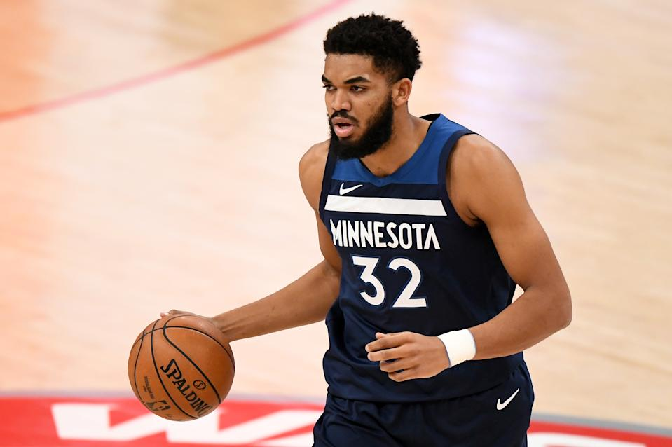 WASHINGTON, DC - FEBRUARY 27: Karl-Anthony Towns #32 of the Minnesota Timberwolves dribbles against the Washington Wizards during the first half at Capital One Arena on February 27, 2021 in Washington, DC. NOTE TO USER: User expressly acknowledges and agrees that, by downloading and or using this photograph, User is consenting to the terms and conditions of the Getty Images License Agreement. (Photo by Will Newton/Getty Images)